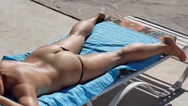 Hotwife exhibitionist tanning spied on by voyeur neighbor